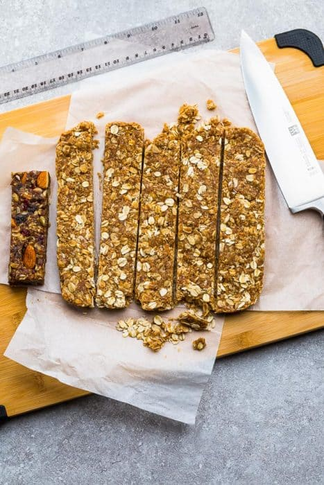 Five Freshly Sliced Bars on a Cutting Board with a Large Knife and a Ruler