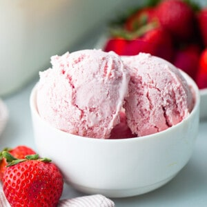 Landscape photo of homemade strawberry ice cream in a white bowl