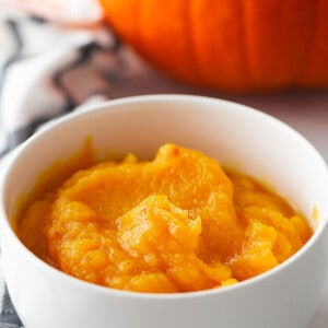 Homemade pumpkin puree in a white bowl