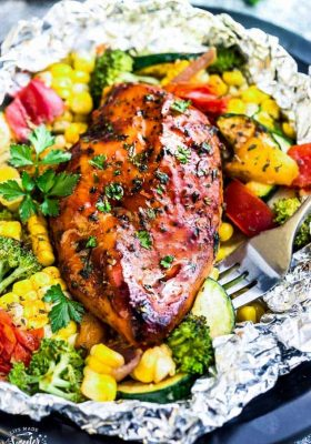 This recipe for Barbecue Chicken Foil Packets (Packs) are the perfect easy meal for summer. Best of all, they can be baked or grilled with practically no clean-up! Made with tender chicken, coated in a sweet and tangy BBQ sauce with your favorite, summer veggies.Great for Sunday meal prep or making ahead for packing into work or school lunches.