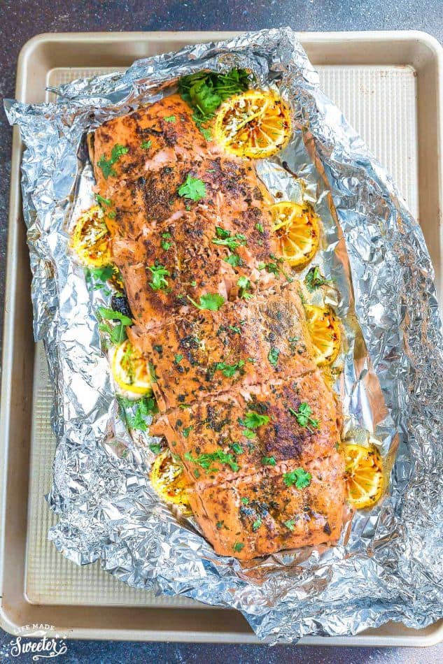 Honey Lemon Salmon in foil is baked to tender, flaky perfection. Best of all, it's fresh, flavorful and super delicious! Comes together in less than 30 minutes and is just perfect for busy weeknights! With sweet and tangy honey, lemon and parsley and the perfect spring or summer meal!