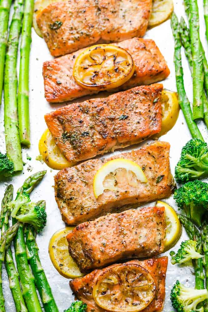 Honey Lemon Salmon with asparagus and broccoli is baked to tender, flaky perfection. Best of all, it's fresh, flavorful and super delicious! Comes together in less than 30 minutes and is just perfect for busy weeknights! Made with a sweet and tangy honey, lemon and parsley and the perfect spring or summer meal! Line baking sheet with parchment paper or foil for easier clean up.