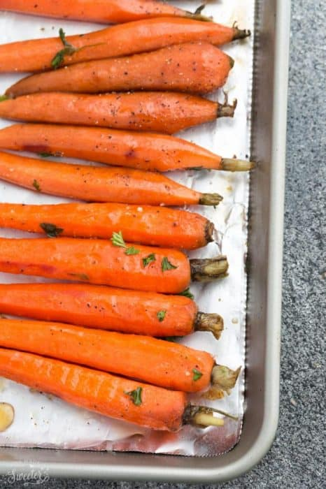 Top view of honey roasted carrots on a sheet pan