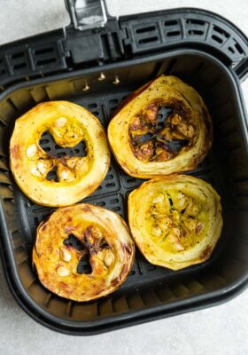 Top view of cooked spaghetti squash rings in an air fyrer basket