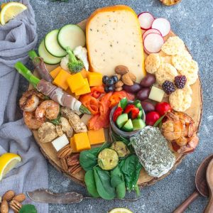 How to Make the Ultimate Charcuterie and Cheese Boards - 6 ways – perfect easy party appetizer tray to make in less than 20 minutes. Everything you need to know to easily build the best charcuterie board plus awesome tips & tricks including 2 low carb / keto boards. Customize using simple pantry ingredients. Recipes include: cured meats, smoked salmon, grilled shrimp, breadsticks, crackers, blue cheese, cheddar, brie, goat cheese, dried fruit, olives, almonds, pecans