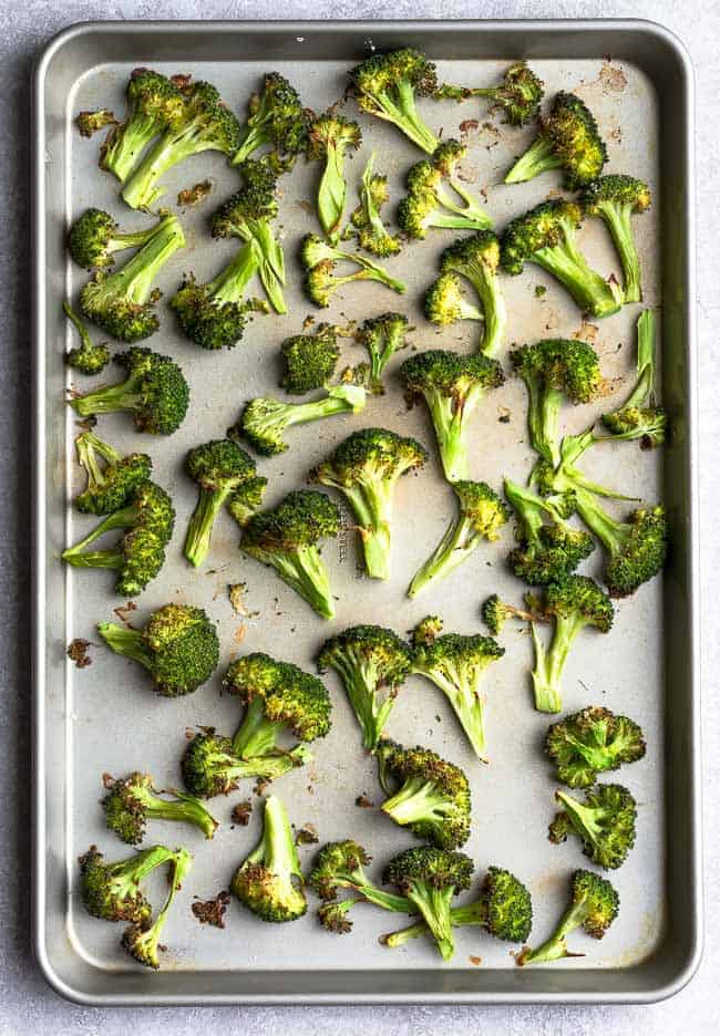 Top view of roasted frozen broccoli on a baking sheet