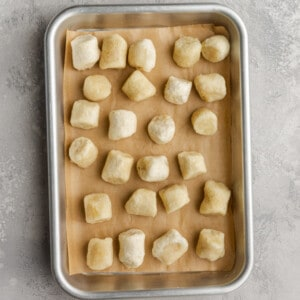 Top view of frozen cauliflower gnocchi on a baking sheet