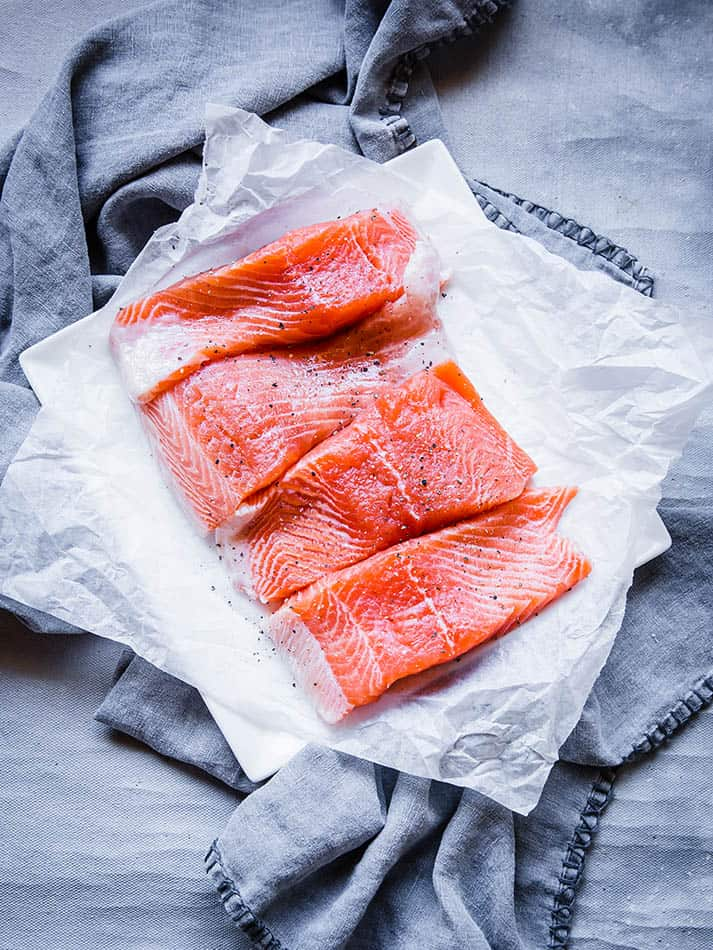 Top view of 4 raw salmon fillets