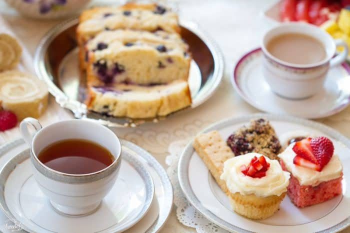 Cups of tea and treats on a table for a tea party