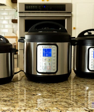 Side view of three Instant Pot pressure cookers on a counter