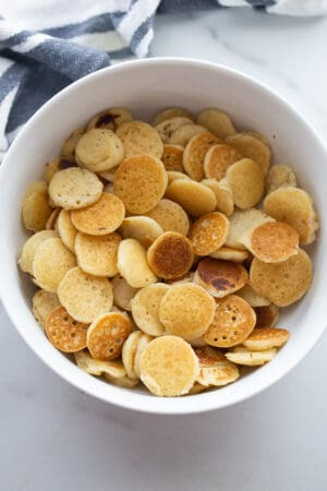 Top view of healthy pancake cereal in a white bowl