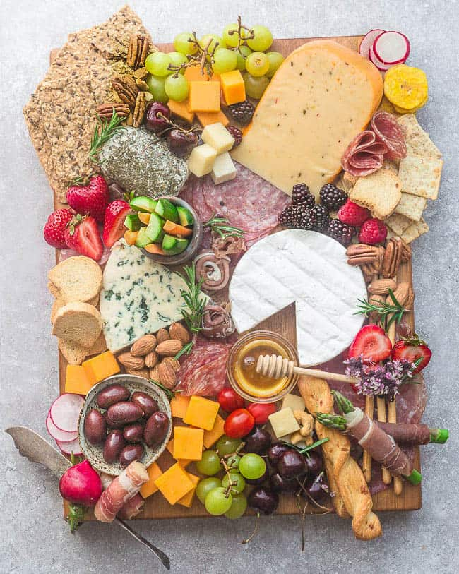 How to Make the Ultimate Charcuterie and Cheese Board - perfect party appetizer trays that you can make in less than 20 minutes. Everything you need to know to easily build an awesome charcuterie board
