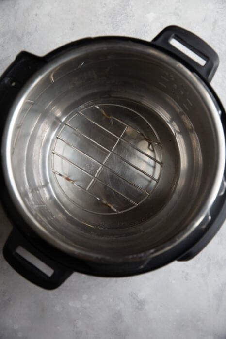 Overhead view of an Instant Pot with a rack in the bottom