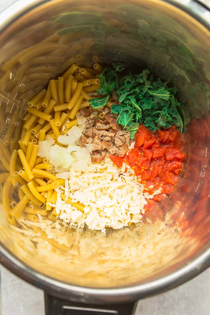 ingredients in the pot of pressure cooker needed to make an Instant Pot Baked Ziti recipe