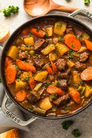 This recipe for Classic Homemade Beef Stew makes the perfect comforting dish on a cold day. Best of all, it's easy to make and has the most delicious tender meat with carrots, potatoes, sweet potatoes and celery. So good for warming up on a cold day and reminds you of mom's home cooking!