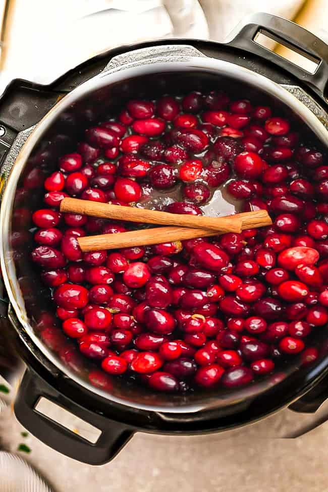 Fresh cranberries in an Instant Pot pressure cooker with cinnamon sticks