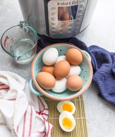 A Bowl of Hard Boiled Eggs Next to an Instant Pot and a Measuring Cup