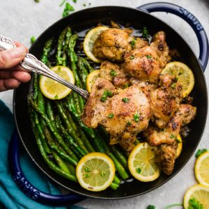 Instant Pot Lemon Garlic Chicken - the perfect low carb & keto friendly meal for spring. Best of all, this recipe is super simple and the chicken cooks up tender, juicy and full of flavor with instructions for the pressure cooker and stovetop. Serve with roasted asparagus, broccoli, zucchini, green beans, cauliflower or your favorite vegetable. Great for meal prep Sunday to make ahead for work or school lunchboxes & lunchbowls