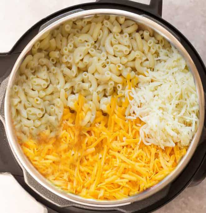 Instant Pot Macaroni and Cheese cooks up perfect & tender in under 30 minutes in the pressure cooker. Best of all, so easy & loaded with 2 cheeses!