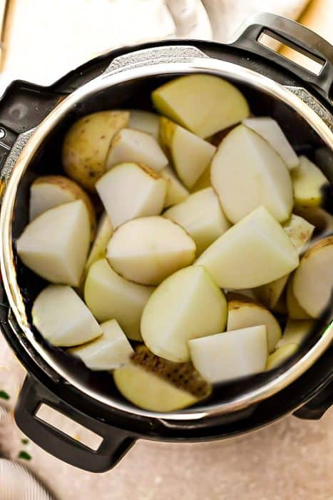 Top view of cut Russet potatoes in a pressure cooker