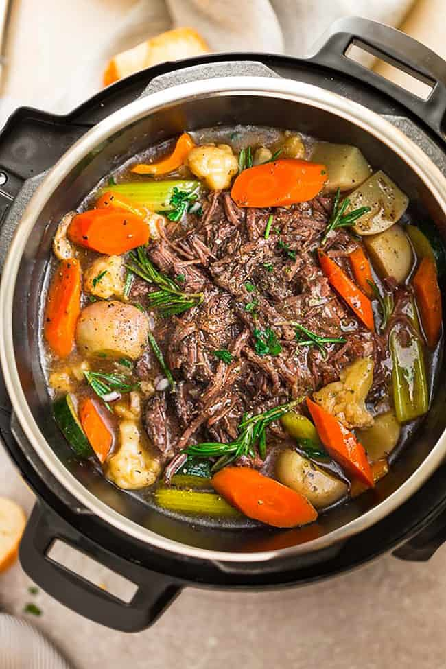 A Pressure Cooker Filled with Chuck Roast Beef and Vegetables