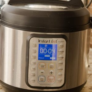 An Instant Pot on a Counter Set to 4 Minutes of Cook Time