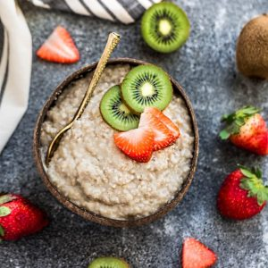 A Bowl Filled with Instant Pot Oatmeal and Fresh Fruit on a Countertop