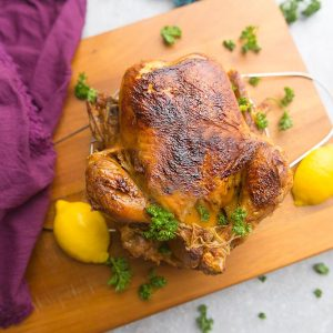 Instant Pot Whole Rotisserie Chicken - perfectly tender, juicy, roasted chicken you can make easily at home using your Instant Pot pressure cooker. Best part of all, you can have a simple chicken dinner in under 45 minutes. Plus instructions for cooking the chicken in the oven, thawed and frozen. No more dry chicken breasts - so juicy and moist & great for Sunday meal prep. Use your leftovers for soups, pastas, casseroles, tacos, bone & chicken broth and more!