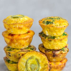 A stack of 9 breakfast egg muffins with jalapeno popper egg muffins at the bottom