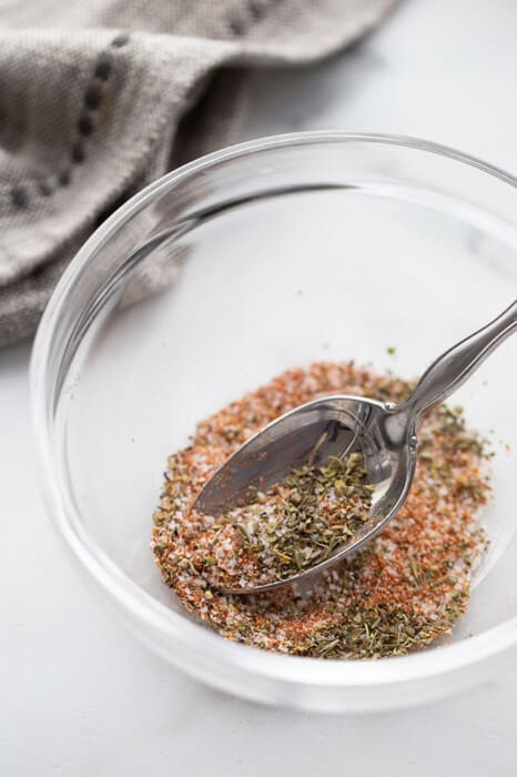 Close-up view of chicken seasoning mix in a clear bowl