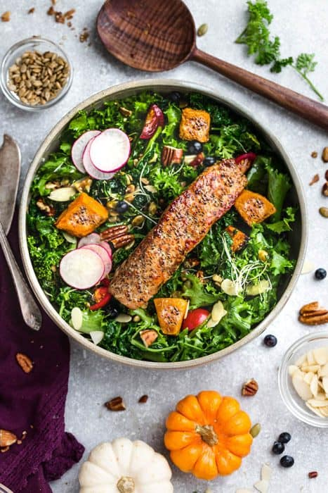 Top view of Autumn Harvest Salad with salmon, pumpkin and radishes - low carb keto version