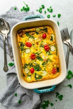 Top view of low carb breakfast egg casserole in a blue casserole pan