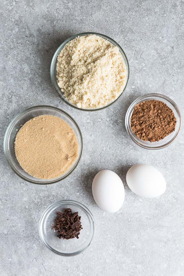 Top view of ingredients to make sugar free keto brownies on a grey background