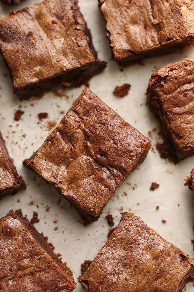 Top close-up view of sliced Keto Brownies on parchment paper