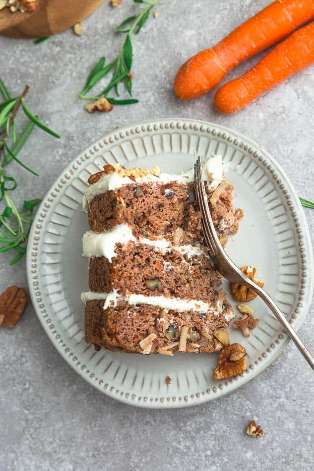 Close up of Paleo Carrot Cake slice with a fork on a white plate