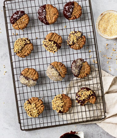 Top view of 12 healthy chocolate peanut butter cookies on a wire rack