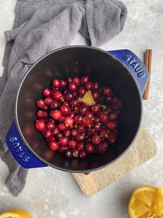 Top view of keto cranberry sauce in a blue pot