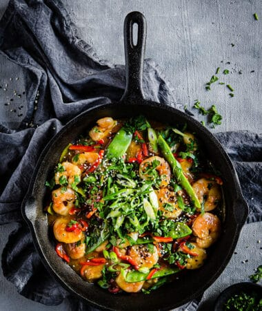 Top view of Keto Shrimp Stir Fry in a black cast iron pan