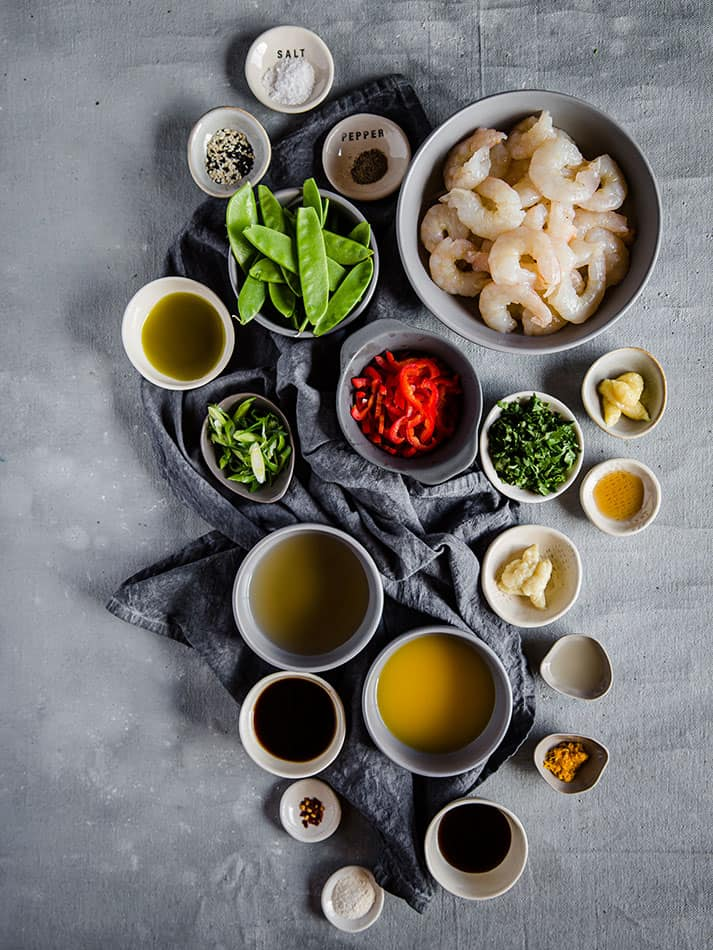 Top view of ingredients to make Keto Shrimp Stir Fry on a grey background