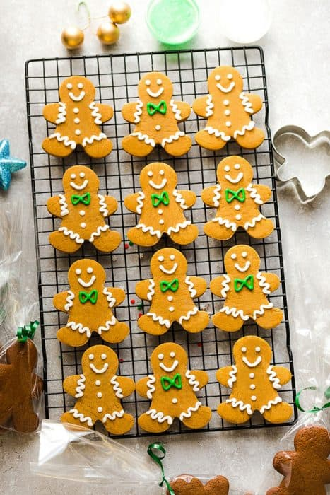 Top view of 12 decorated gingerbread men cookies on a cooling rack