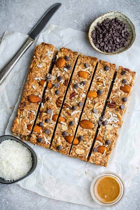 Top view of 4 keto granola bars on a grey background