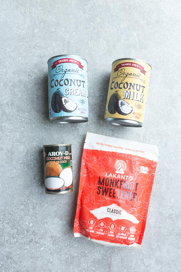 Top view of ingredients to make Keto Ice cream on a grey background - coconut cream, coconut milk and monk fruit sweetener