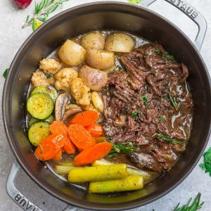 Top view of Instant Pot Pot Roast with shredded meat, celery, carrots and turnips.