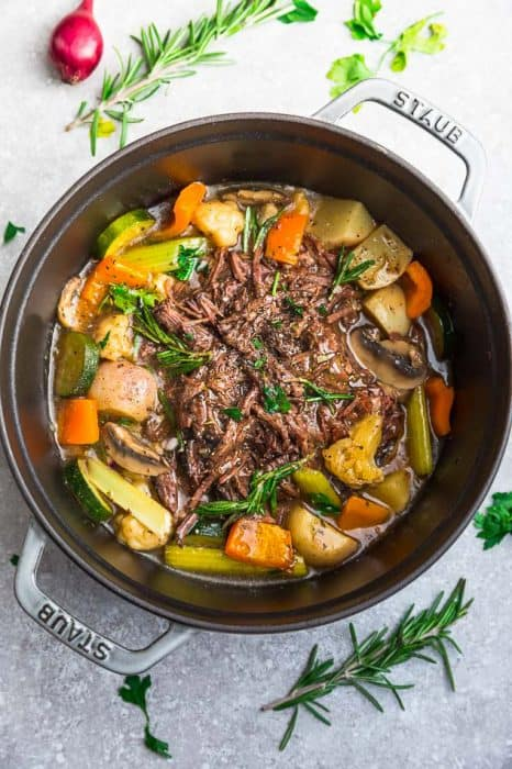 The Top View of an Instant Pot Filled with Shredded Meat, Celery, Carrots and Turnips.