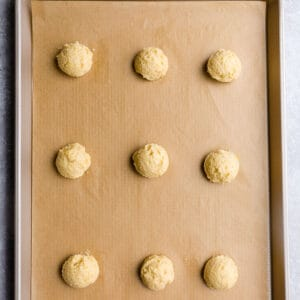 Top view of unbaked keto low carb lemon cookies on a baking sheet
