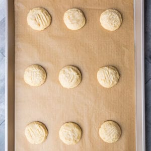 Top view of baked keto low carb lemon cookies on a baking sheet