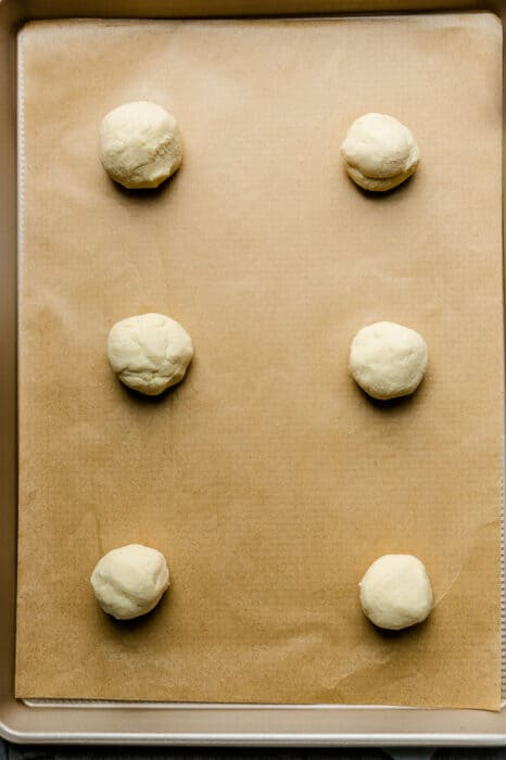 Top view of six Low Carb Keto Bagel dough balls ready to be baked