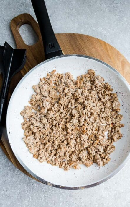 Top view of ground meat for Paleo Egg Roll in a Bowl in a pan