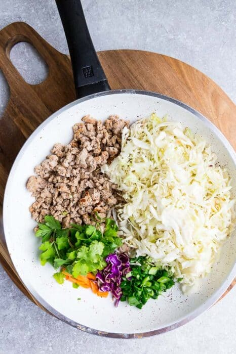 Top view of ingredients of Keto Egg Roll in a Bowl in a pan