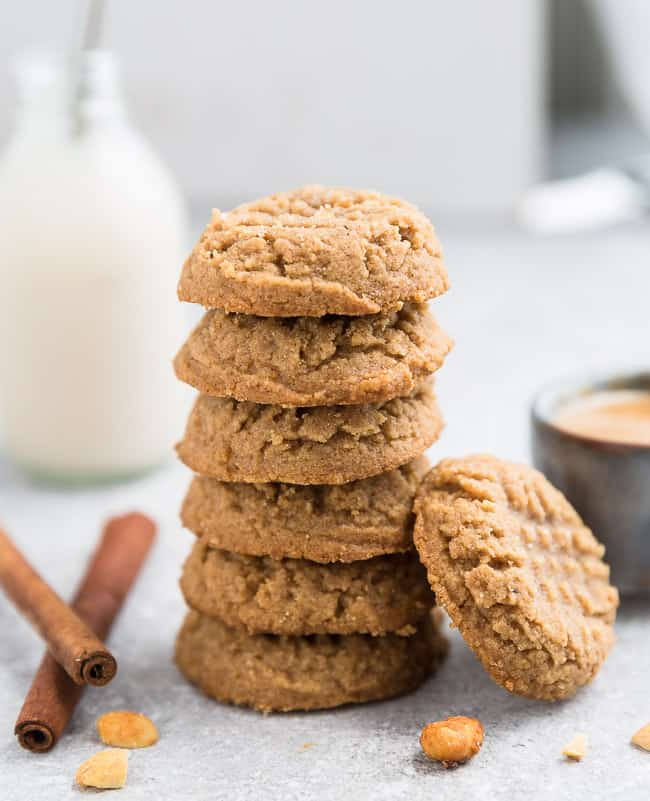 A stack of keto peanut butter cookies with criss-cross designs on top of each cookie